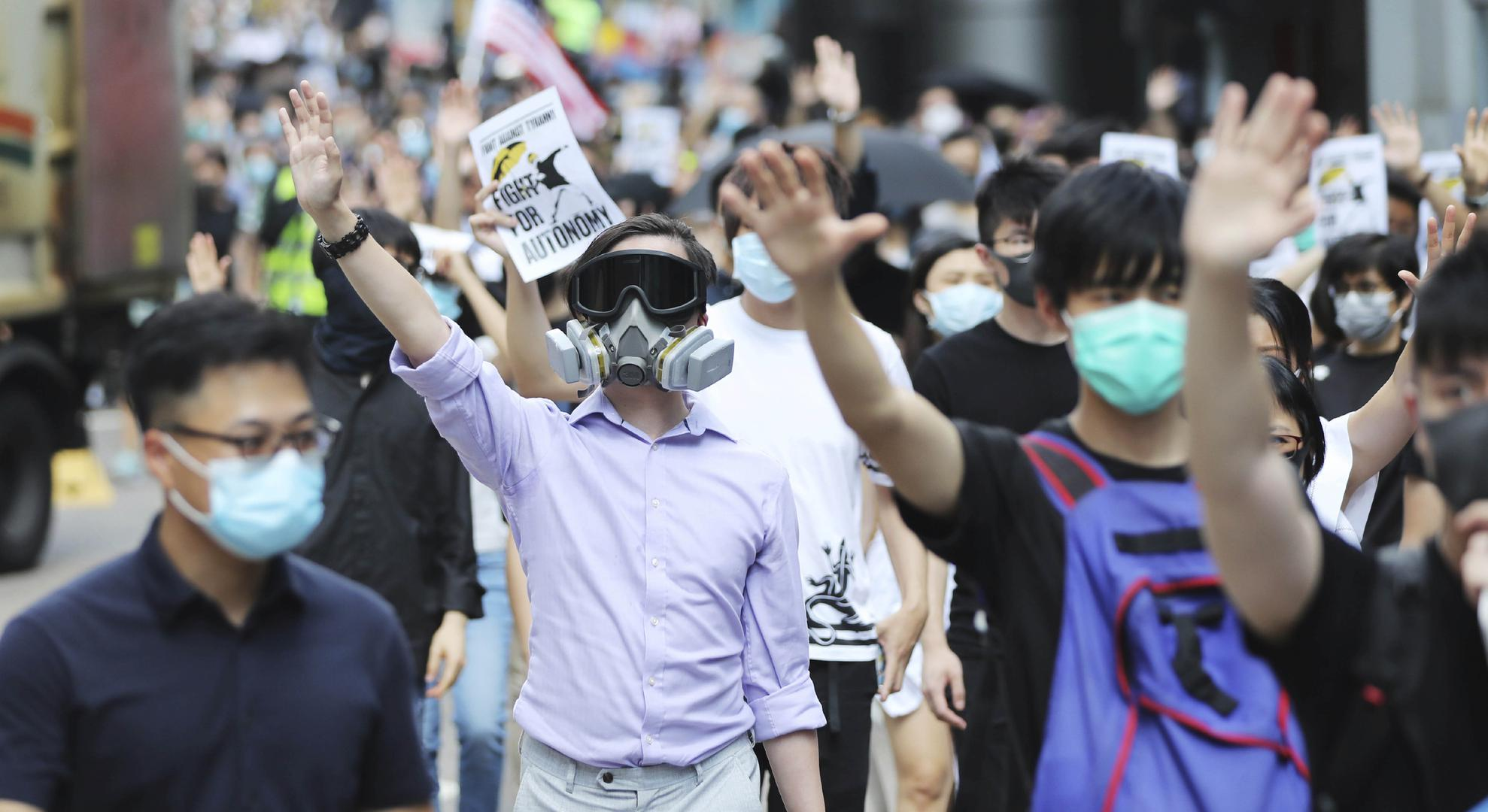 People protest the enactment of the anti-mask law in Hong Kong, October 4, 2019.