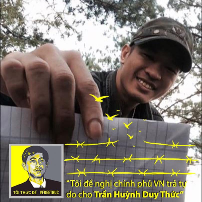 "Nguyen Quoc Duc Vuong supports prominent blogger Tran Huynh Duy Thuc, who is serving a 16-year prison sentence. His sign reads, ""I recommend the government of Vietnam to release Tran Huynh Duy Thuc."""