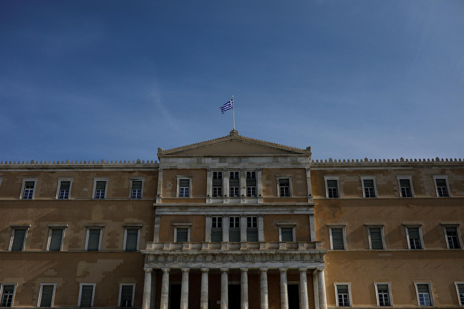 A Greek national flag flutters atop the parliament building in Athens, Greece, January 28, 2019.