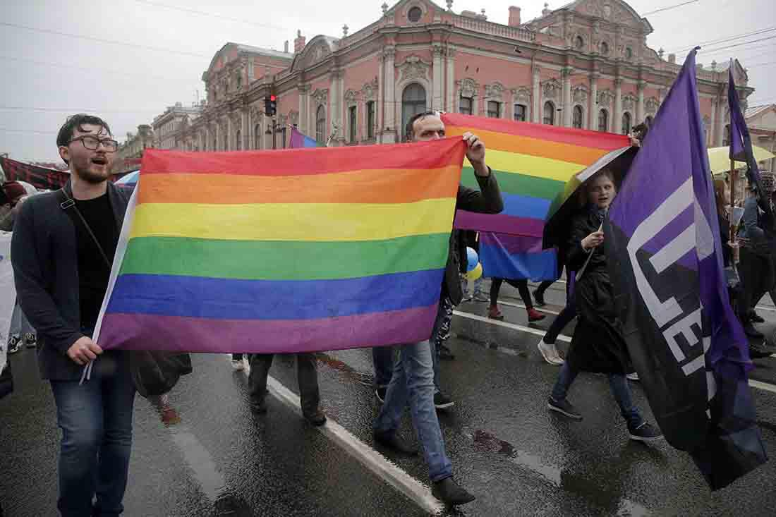 LGBT rights activists carry the rainbow flag during a May Day rally in St. Petersburg, Russia.