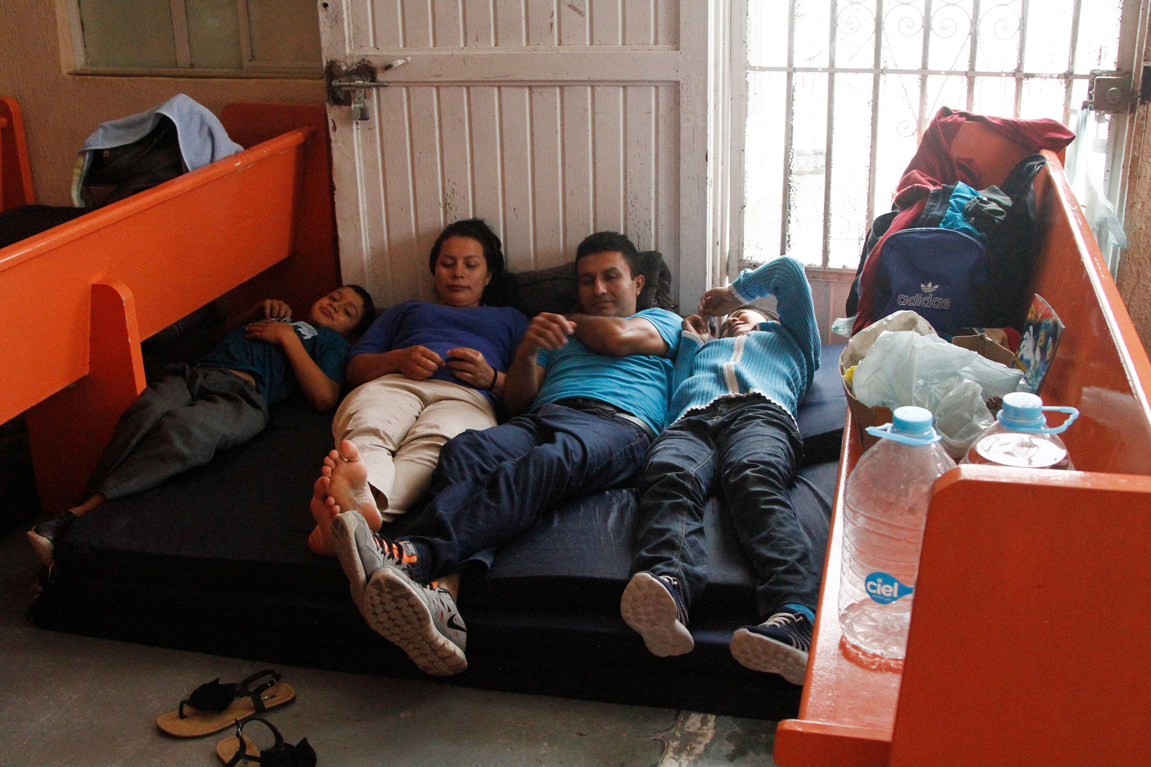 A Salvadoran family stays at the Buen Pastor migrant shelter in Ciudad Juárez, Mexico, in June 2019 while they wait for their asylum cases to be heard in US immigration court.
