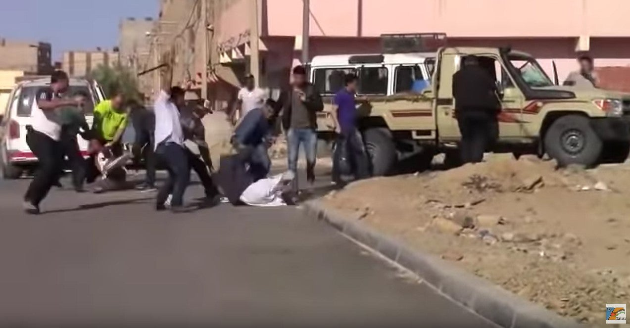 Screenshot of a video showing policemen severely beating two activists in Smara, Western Sahara, on June 7, 2019.