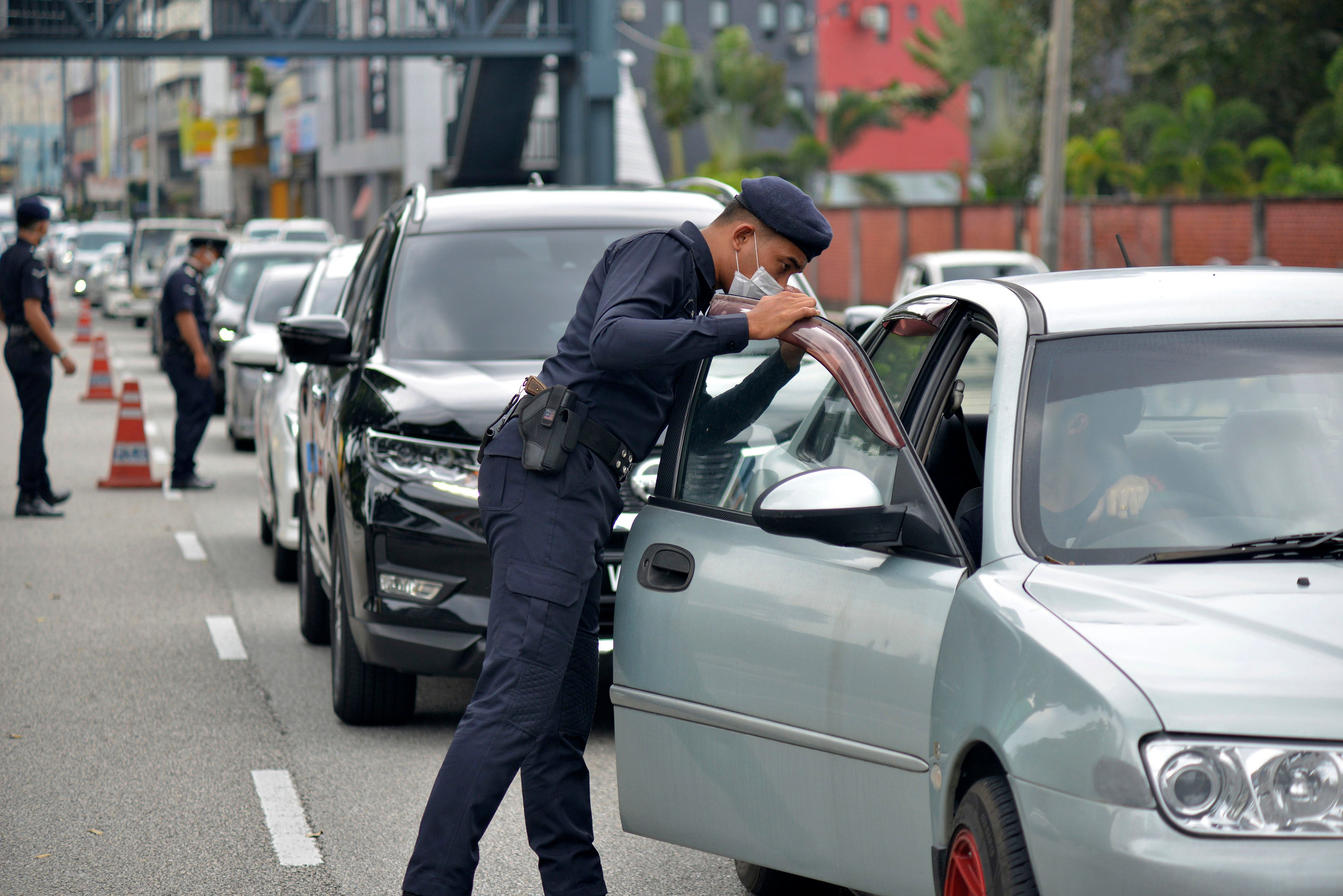 Is it safe to ask a policeman for his authority card?