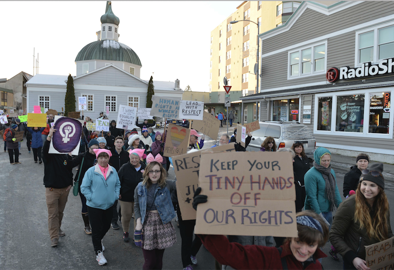 Hundreds of people march in downtown Sitka, Alaska, during the women's march, held in solidarity with the Women's March on Washington, Saturday, Jan. 21, 2017.