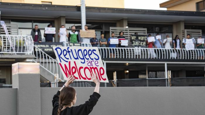 Asylum seekers and human rights activists protest against the detention of refugees amid the Covid-19 crisis in Brisbane.