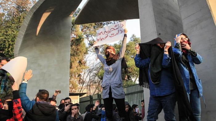 Iranian students protest at the University of Tehran during a demonstration driven by anger over economic problems, in the capital Tehran on December 30, 2017.