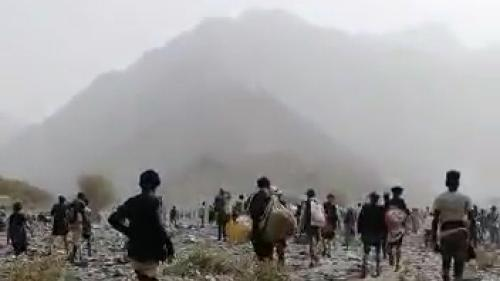 Migrants walking in mountains
