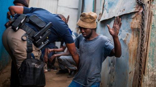 South African man being searched by police