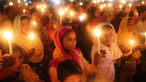 A crowd of women holding candles