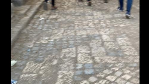 This video shows scenes of a man's body being carried and attended to by a priest near the Arbatu Ensessa church in Axum. Video sent to Human Rights Watch that according to the videographer and the video's metadata was recorded on November 29. These clips have been edited to protect the identity of the person filming and to remove graphic scenes.
