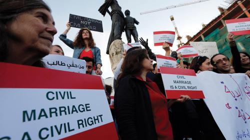 Activists hold placards during a protest demanding civil marriage in Lebanon. There is currently no Lebanese civil personal status law.