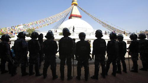 Nepalese police stand guard at the premises of the Boudhanath Stupa after a Tibetan monk self-immolated in Kathmandu on February 13, 2013.
