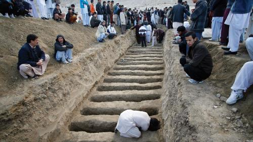 A man prepares graves for the victims of the February 17, 2013 vegetable market bomb attack in a Shia Hazara area of Quetta city in Pakistan.