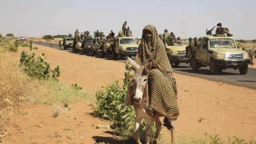 A government military convoy on its way to Tabit town in North Darfur, Sudan, November 20, 2014.