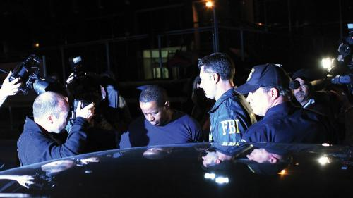 Federal agents and police escort James Cromitie (center) from the FBI's New York headquarters on May 21, 2009.