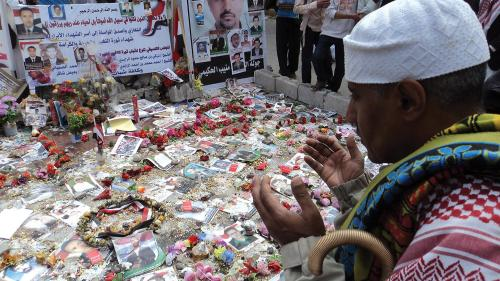 A ceremony honoring those killed in the Friday of Dignity massacre in Sanaa, Yemen, on March 18, 2011, held one week later at the site of the killings.  The text on the posters contains a prayer and names of the dead.