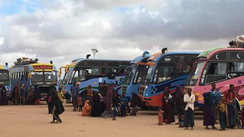 Photo of Somali refugees getting on buses to leave Dadaab refugee camp.