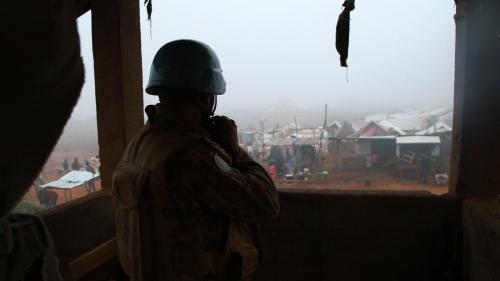 A United Nations peacekeeper in Kaga-Bandoro, Central African Republic, looks out over the new displacement camp near the airstrip that formed after the October 12 attack.