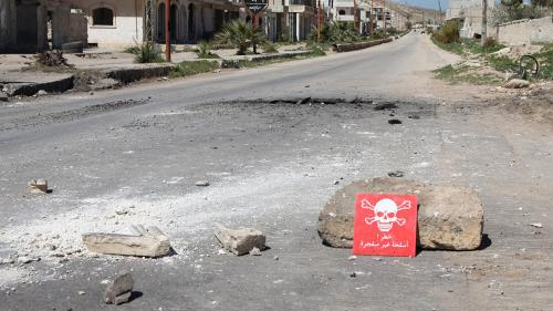 A poison hazard danger sign is seen in the town of Khan Sheikhoun, Idlib province, Syria on April 5, 2017. © 2017 Abdussamed Dagul/Anadolu Agency/Getty Images