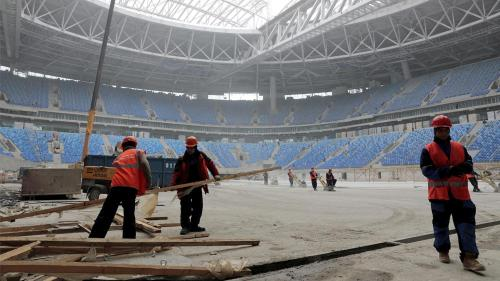 Construction workers on the St. Petersburg Stadium in St. Petersburg, Russia that will host 2017 FIFA Confederations Cup and 2018 FIFA World Cup matches. October 3, 2016.