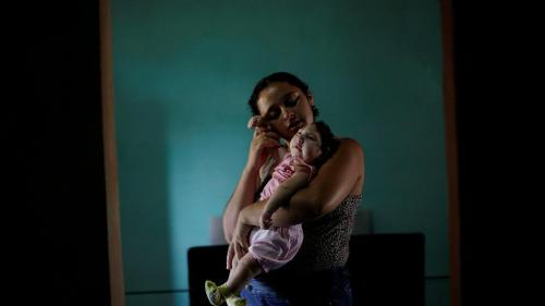 "Raquel, 25, holds her daughter Heloisa in Areia, Paraíba state, Brazil. Raquel gave birth to twin daughters with Zika syndrome in April 2016. ""I want to give my best to my daughters,"" she said in an interview with Human Rights Watch."