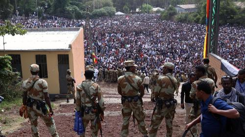 Armed security forces watch during the Irreecha cultural festival in Bishoftu, Ethiopia on October 2, 2016.