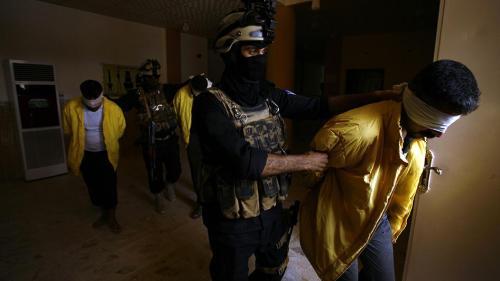 Iraqi Military hold ISIS suspects
