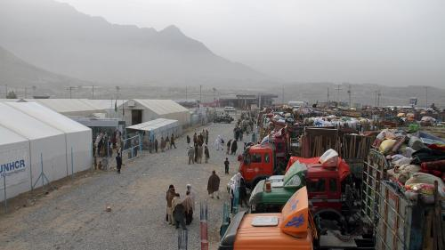 Trucks hired by Afghan refugees forced out of Pakistan and packed with their belongings line up at the UN refugee agency's support center outside Kabul, October 2016.