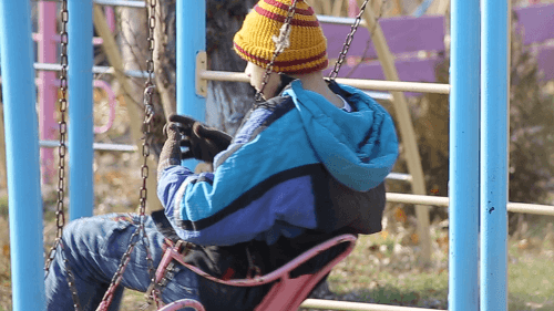 Child playing on a swing in an institution in Armenia.