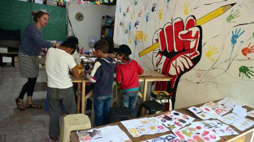 Children seeking asylum attend an art class at the volunteer-run Refugee Education Chios center on the Greek island of Chios on September 29, 2016.