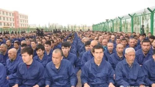 Government social media post in April 2017 shows detainees in a political education camp in Lop County, Hotan Prefecture, Xinjiang.