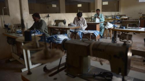 Garment workers making shirts at a factory in Karachi, Pakistan, February 2015.