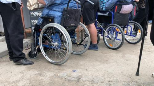 People in wheelchairs at a checkpoint in Eastern Ukraine