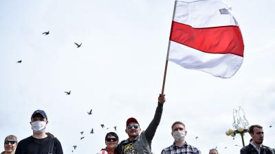 Man waving Belorussian flag
