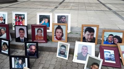 Photos of Syrians who have been detained or disappeared set up by Families for Freedom, as part of a protest in front of the court in Koblenz, July 2, 2020.