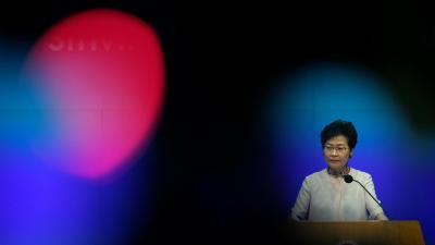In this Oct. 10, 2018, photo, Hong Kong Chief Executive Carrie Lam attends a question and answer session after delivering her policy speech at the Legislative Council in Hong Kong.