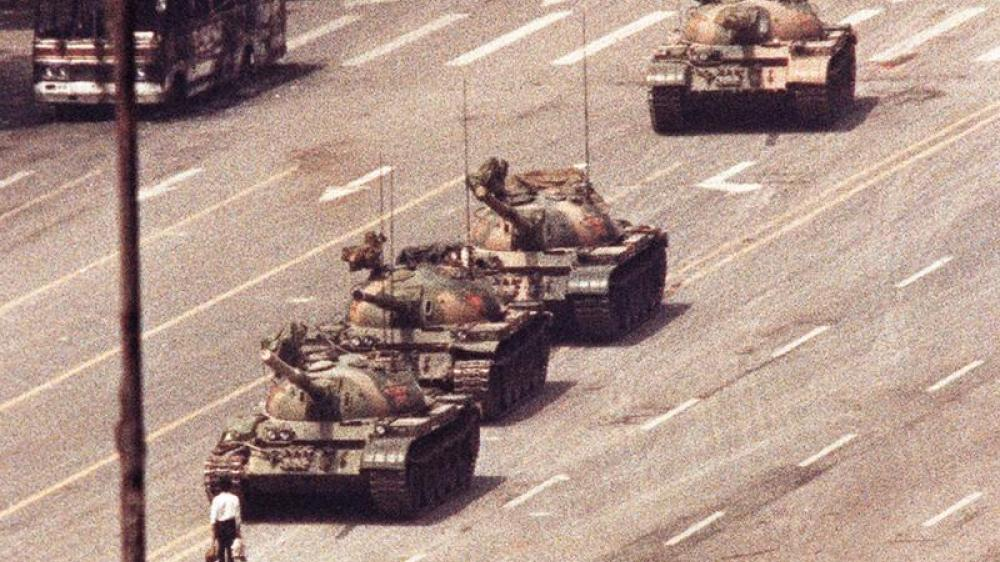 A man stands in front of a convoy of tanks in the Avenue of Eternal Peace in Tiananmen Square in Beijing in this June 5, 1989 file photo.