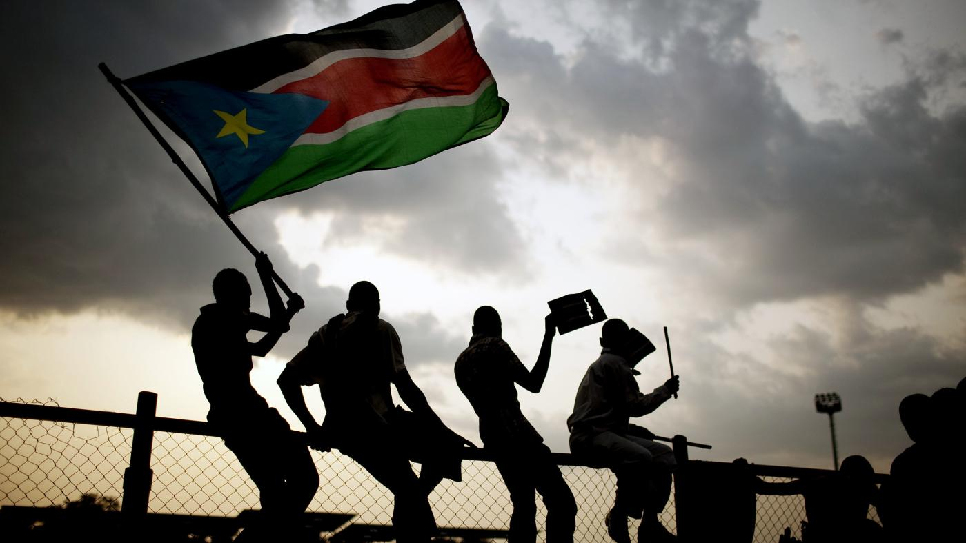 Southern Sudanese wave the national flag and cheer at South Sudan's first national soccer match after the country declared its independence, in the capital Juba on July 10, 2011
