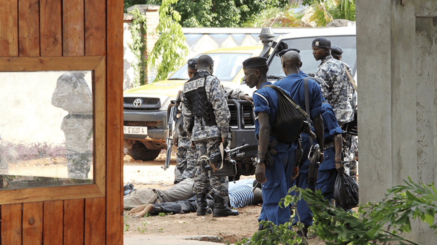 Burundian police hold suspects after discovering an alleged ammunition cache near Bujumbura, December 9, 2015.