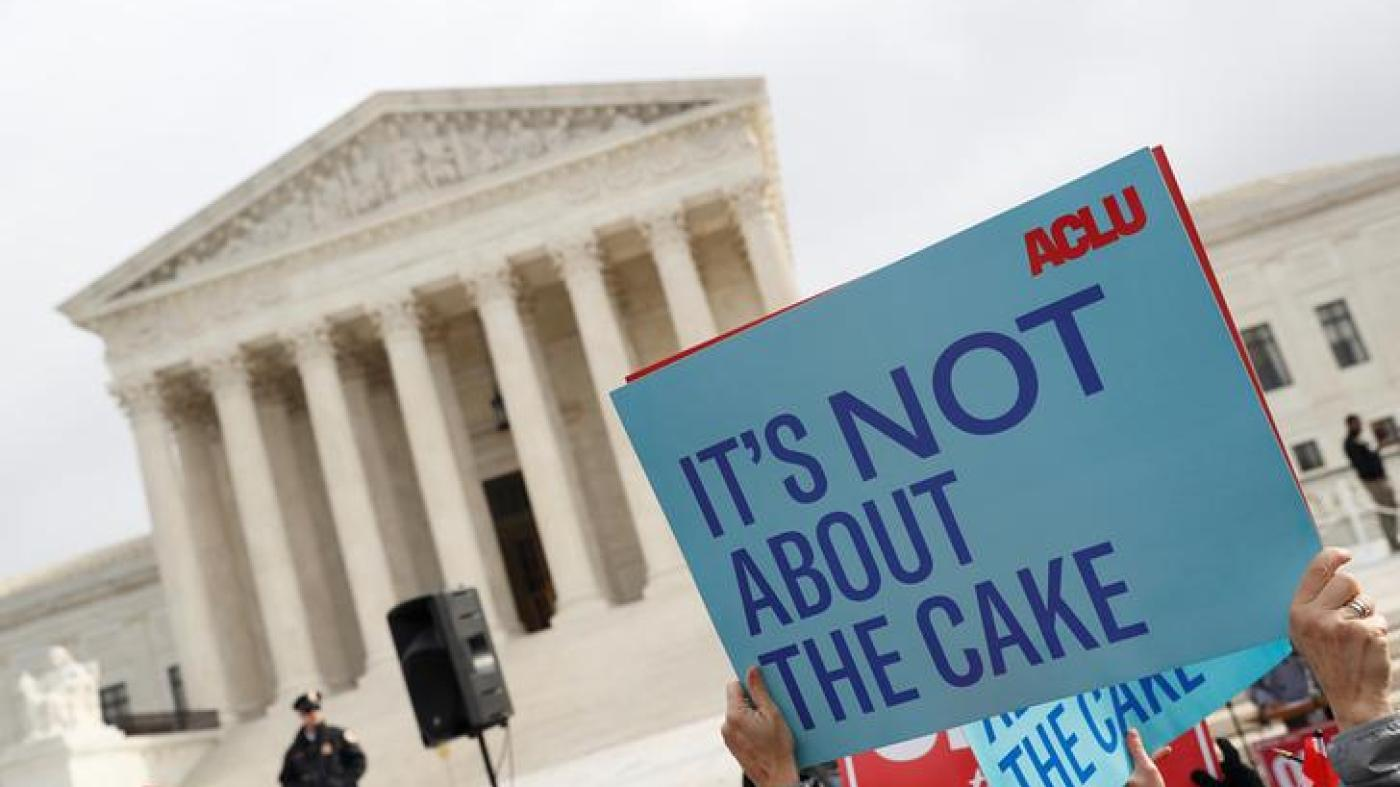 Demonstrators protest during oral arguments in the Masterpiece Cakeshop vs. Colorodo Civil Rights Commission case at the Supreme Court in Washington, U.S., December 5, 2017.