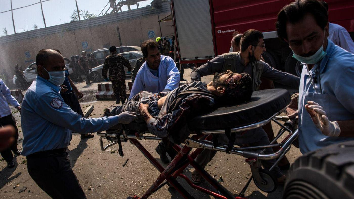 Medical workers transport an injured man on a stretcher to an ambulance near the site of a truck bomb in Kabul, May 31, 2017.