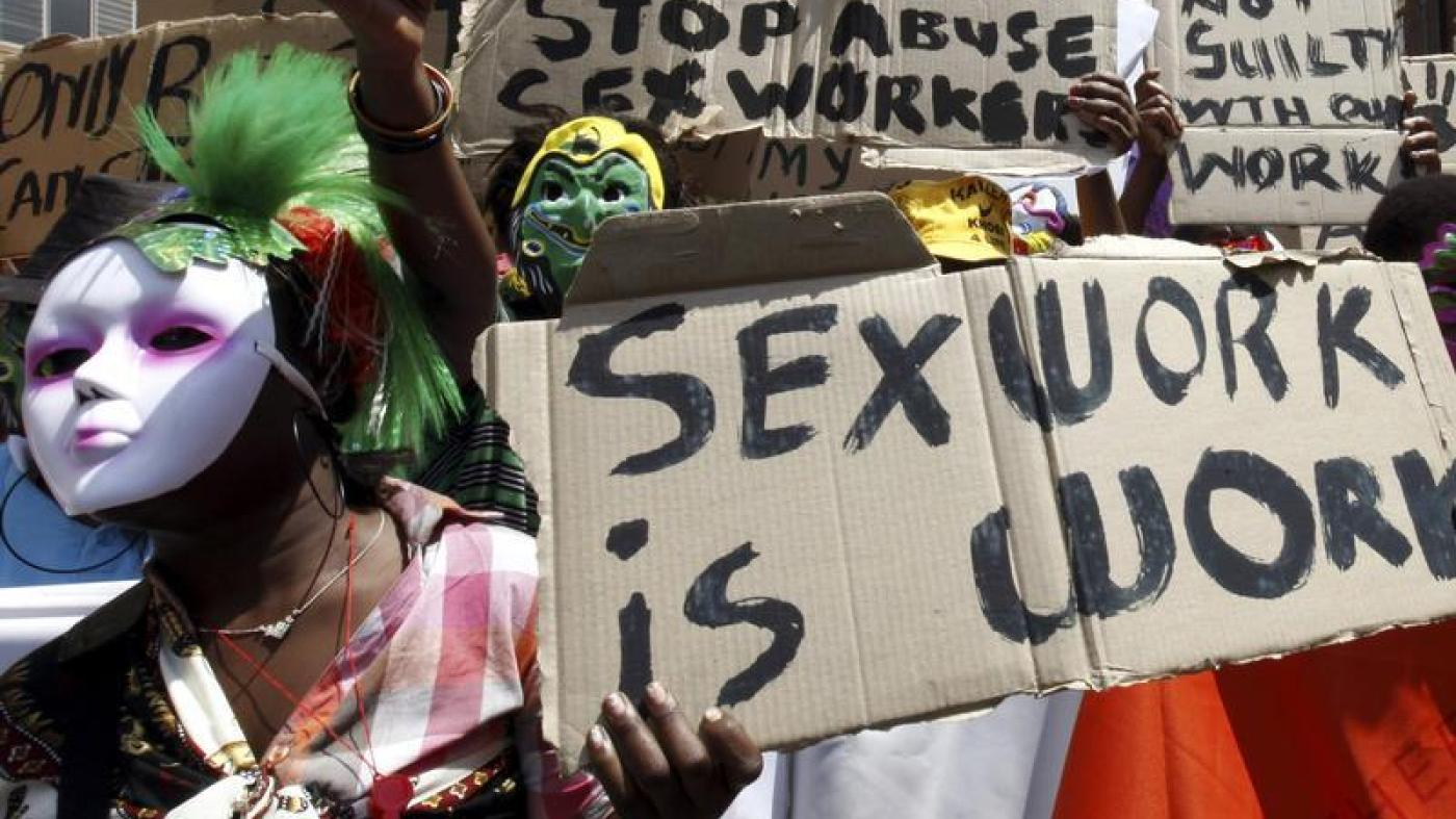 Sex workers wearing masks lead a march to mark International Sex Workers Rights Day in Johannesburg March 3, 2011