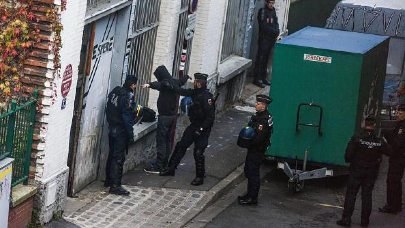 Police raid a building suspected of housing climate activists in Paris on November 27, 2015, prior to the UN COP21 climate change summit. © 2015 AFP/Laurent Emmanuel