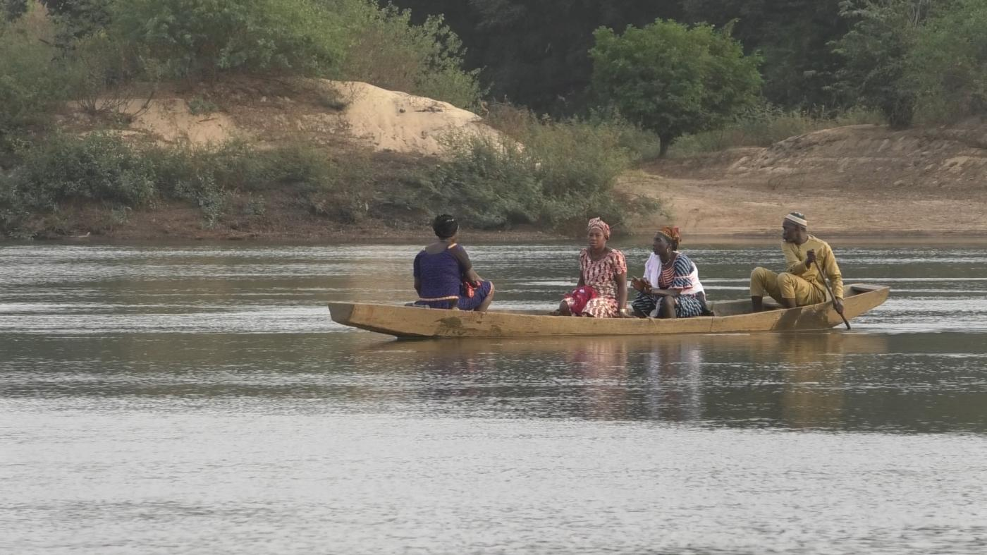 Three people in a canoe