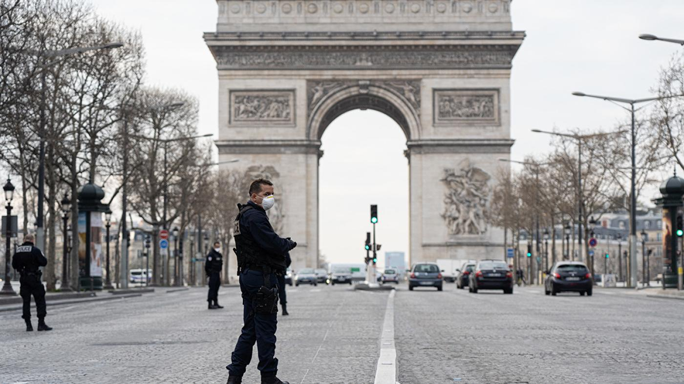 Police patrol near the Arc de Triomphe on the first day of confinement due to COVID-19, Paris, France, March 17, 2020.