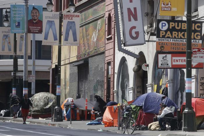 Tents line a sidewalk on Golden Gate Avenue in San Francisco, Saturday, April 18, 2020.