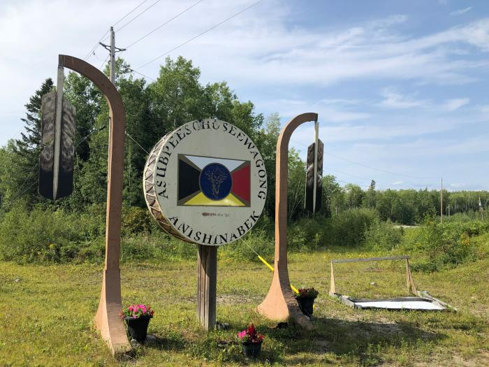 Sign entering Grassy Narrows First Nation, in northwestern Ontario, Canada.