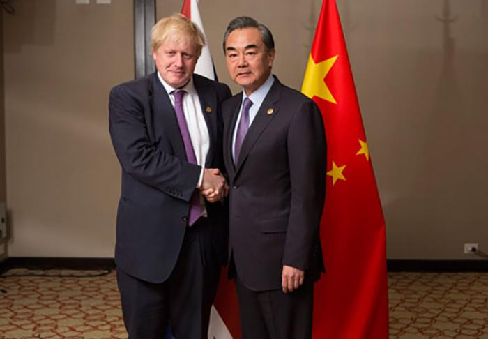 Then-United Kingdom Foreign Secretary Boris Johnson (L) meets with Chinese Foreign Minister Wang Yi at the G20 Foreign Ministers meeting in Buenos Aires, May 2018.