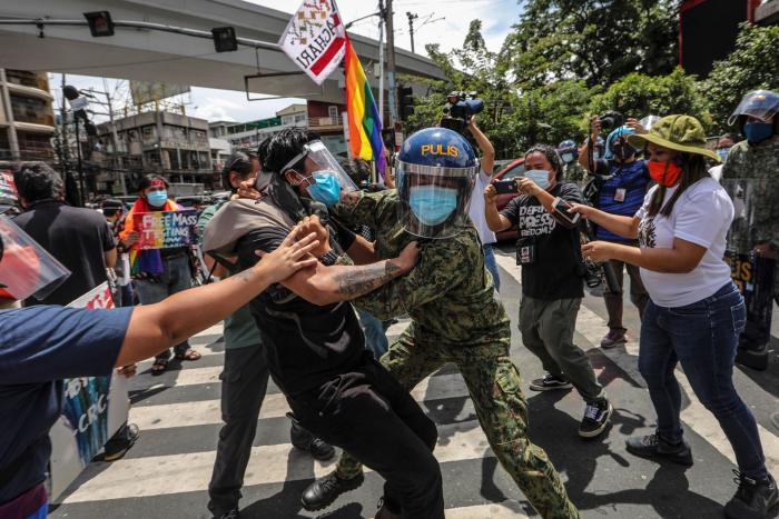 Police arrest protesters during a Pride march in Manila, Philippines, June 26, 2020.