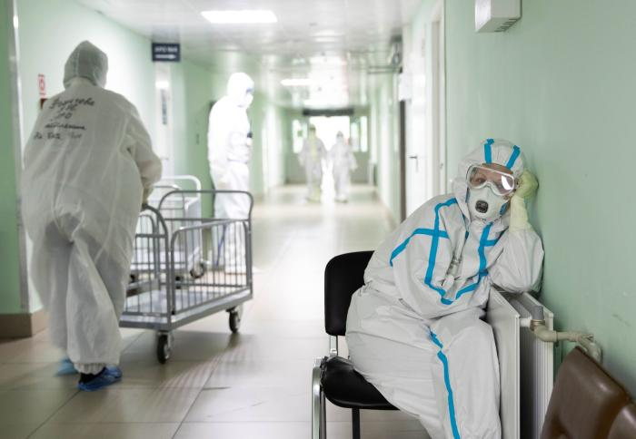 A medical specialist wearing personal protective equipment (PPE) takes a break at the City Clinical Hospital Number 15 which delivers treatment to COVID-19 patients in Moscow, Russia May 25, 2020.